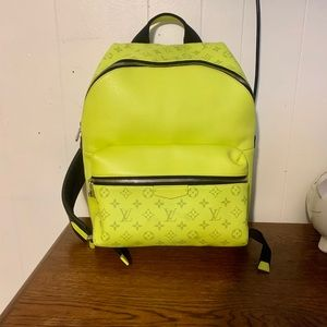 Louis Vuitton chain purse and backpack.